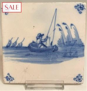 Tile with a fisherman in a boat, circa 1725. Tegel met een visser in een boot, circa 1725.