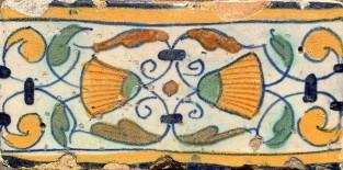 Rand tegels met een bloem ca 1600-1610
