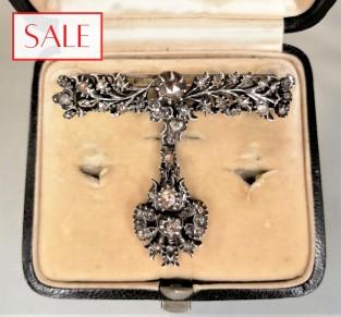 Antique silver brooche with rose cut diamonds. Antieke zilveren broche met roosgeslepen diamanten.
