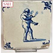 Tile with a pipe smoker, circa 1650. Tegel met een rokende man, circa 1650.-20