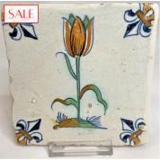 Polychrome tile with a tulip, circa 1625. Polychrome tegel met een tulp, circa 1625.-20